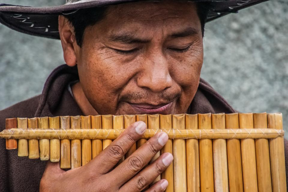 people man hand bamboo flute musical instrument indonesia