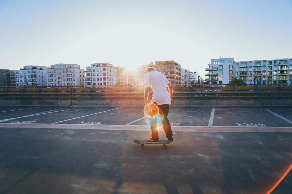 buildings structure condominium people man skateboarding sport sunlight sunshine sunrise sunset sky bridge
