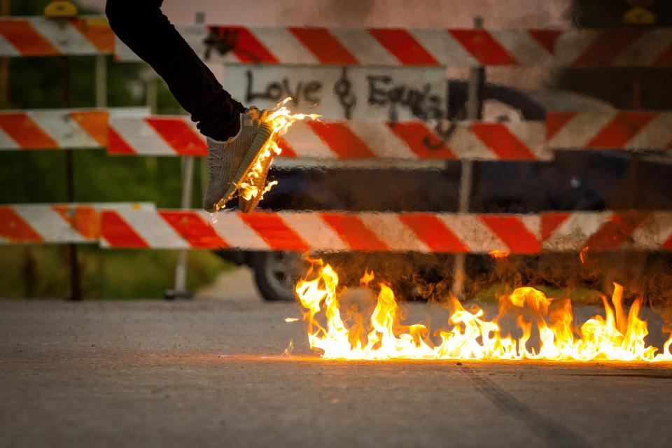 fire shoes flame street fence road jump heat smoke