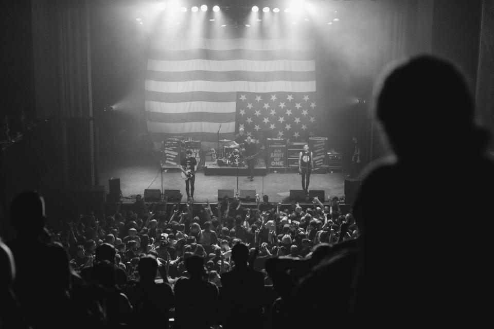 black and white concert people crowd american flag singer music microphone speakers