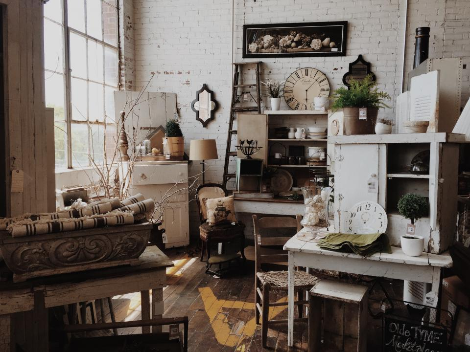 still items things vintage post modern furniture art interior design shelves chairs tables pots vase decor decorative plants mirror clock paintings pillows window whitewashed brick walls white brown beige room showroom display model unit