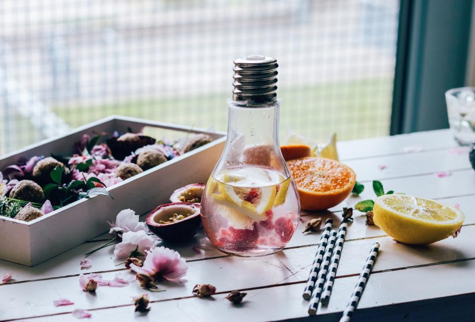 lifestyle water food fruits orange lemons petals pink bulb glass