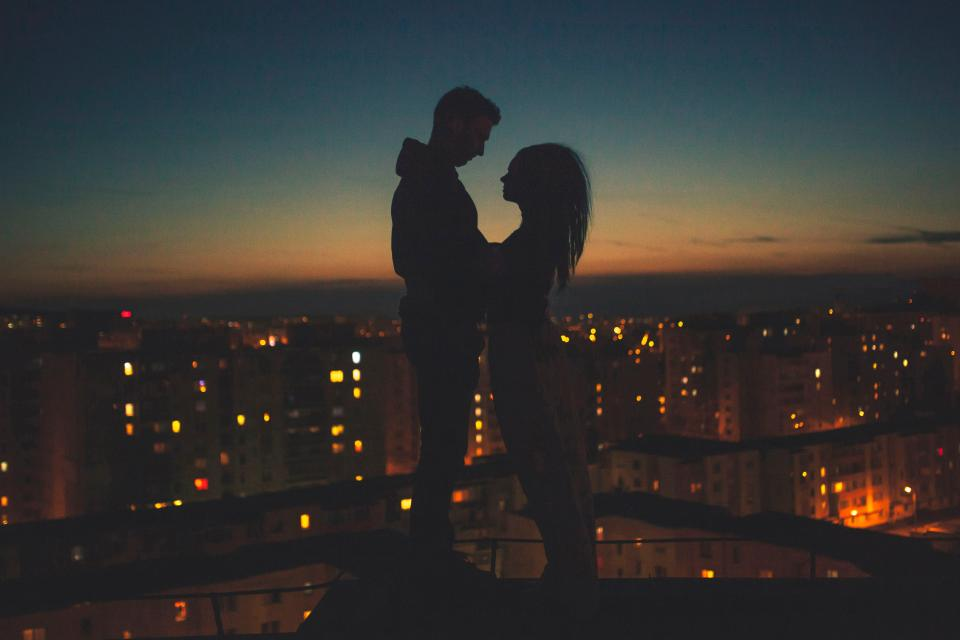 people man woman couple love silhouette sweet intimate sunset clouds sky dark shadow urban city lights building establishment