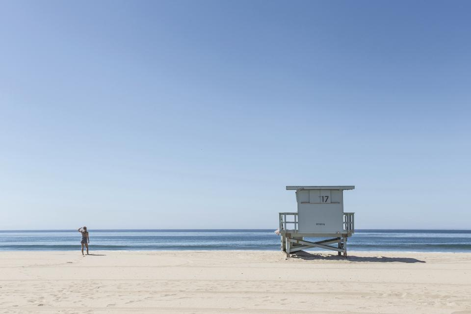 beach sand sunshine summer ocean sea lifeguard hut girl woman people blue sky