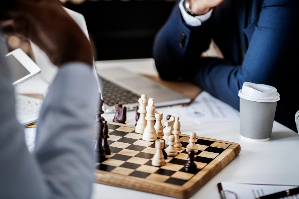 business strategy challenge chess closeup competition decision diversity formal game hands help mind game mind games performance planning playing solution strategy strength success tactic target team teamwork