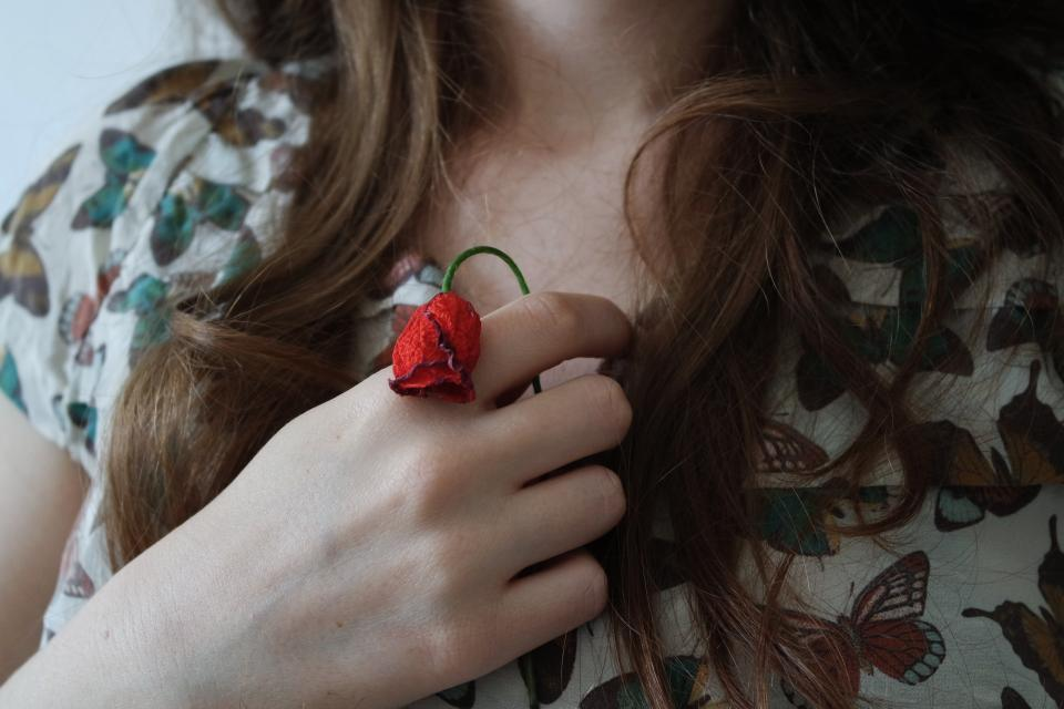 hands chest girl people hair red flower
