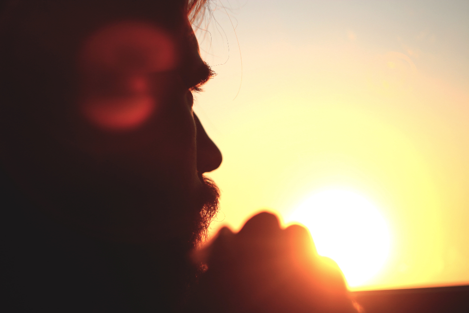 guy man sunset moment dusk summer thinking pondering silhouette sky rays looking horizon people