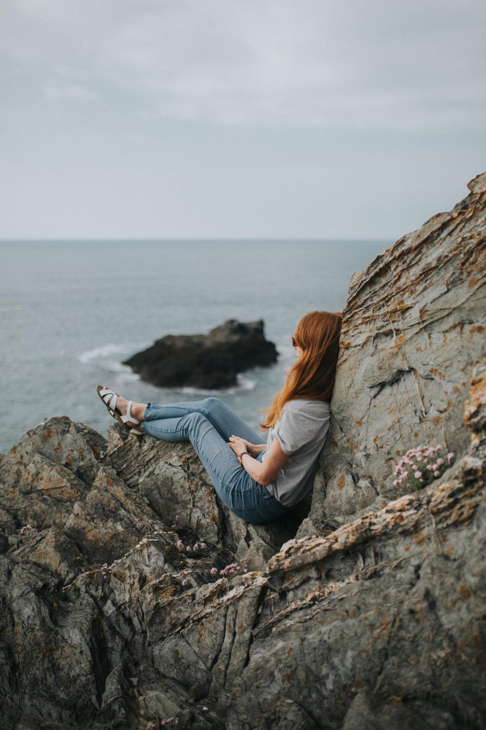 sea ocean water waves nature rocks hill cliff people girl sitting alone adventure outdoor relax view