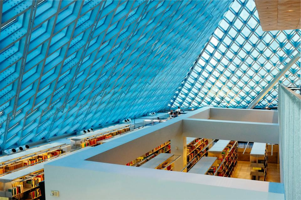 library books shelves skylight ceiling beams roof building architecture glass