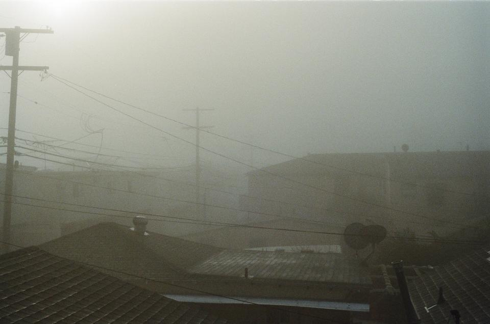 fog sky rooftops buildings houses