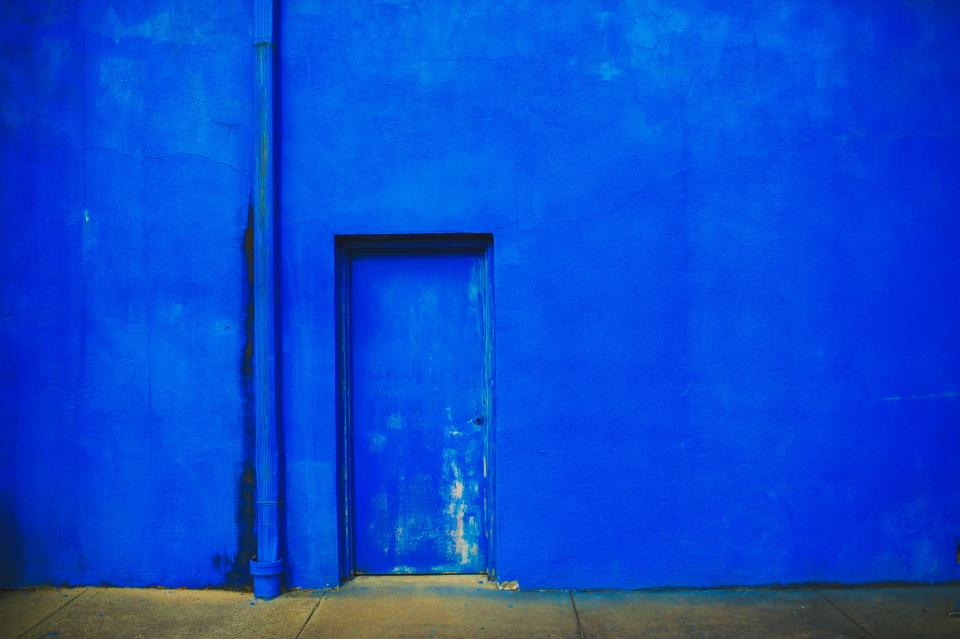 blue concrete wall door