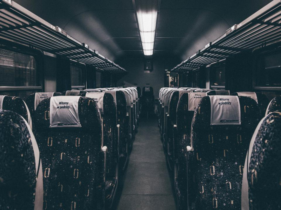 bus train transportation seats aisle night evening lights