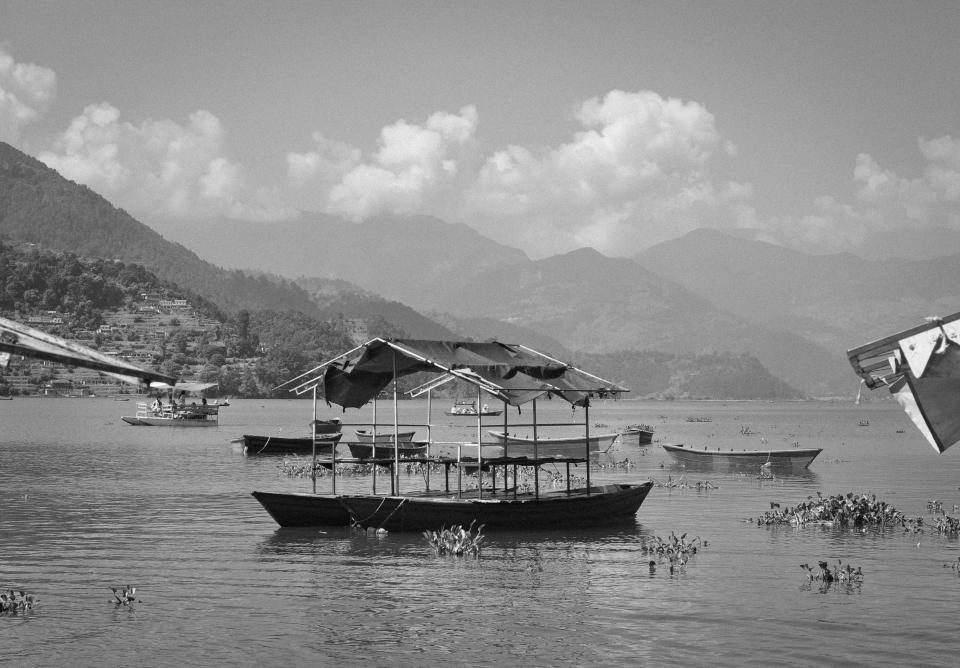 Fewa Lake boats water coast mountains hills Pokhara Nepal black and white