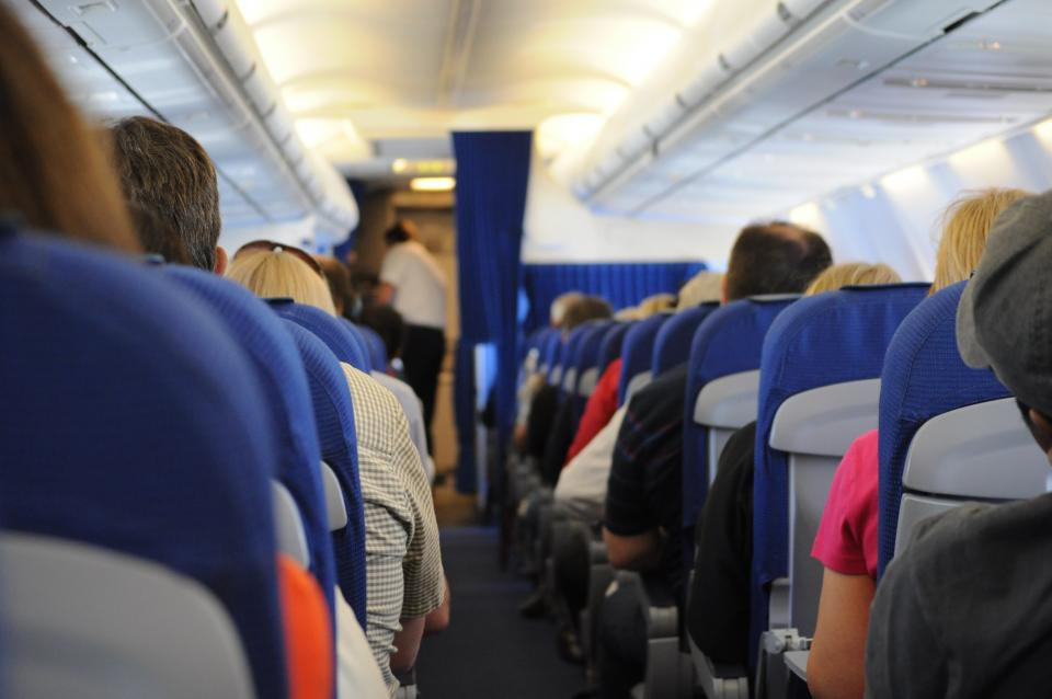 airplane on board seats people travel transportation aisle