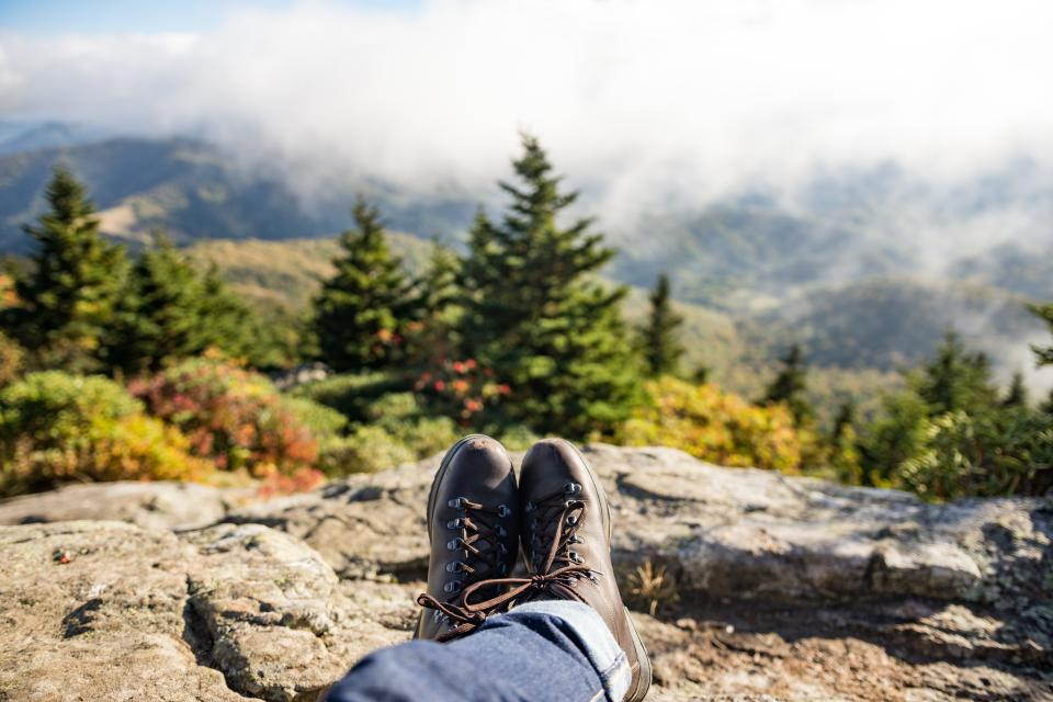 shoes travel leather brown trees rock fog sky clouds nature adventure