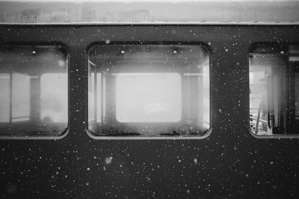 subway windows cold snow travel transport grey black and white