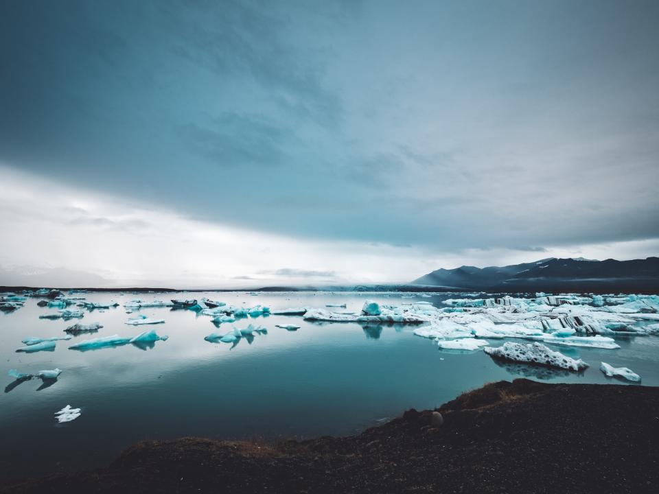 sea ocean water nature ice iceberg mountain landscape clods sky coast