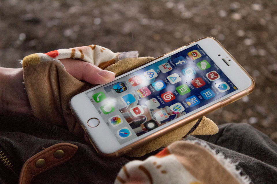 phone apps hands iphone gloves woman ios mobile technology people