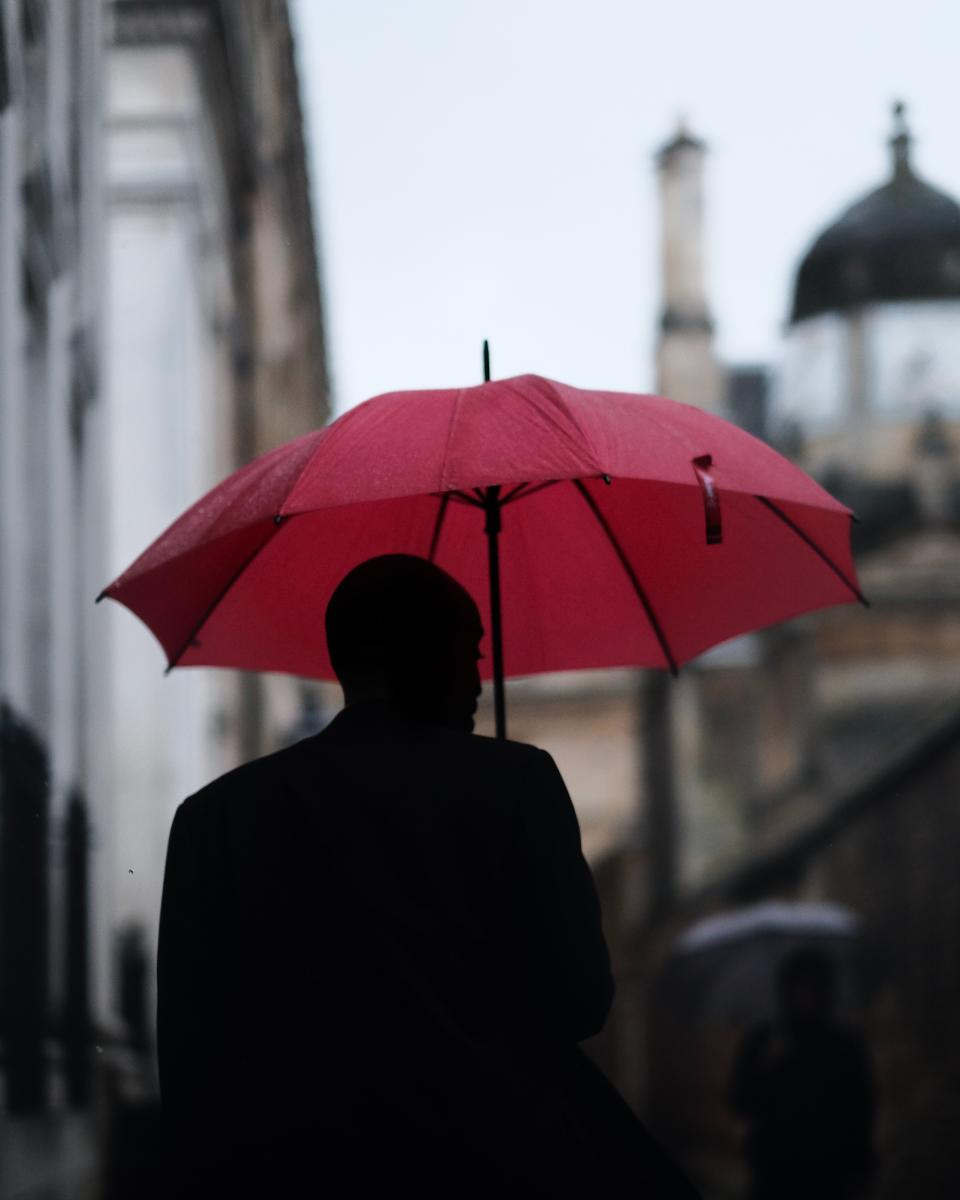 people man guy umbrella rain silhouette blur city walking