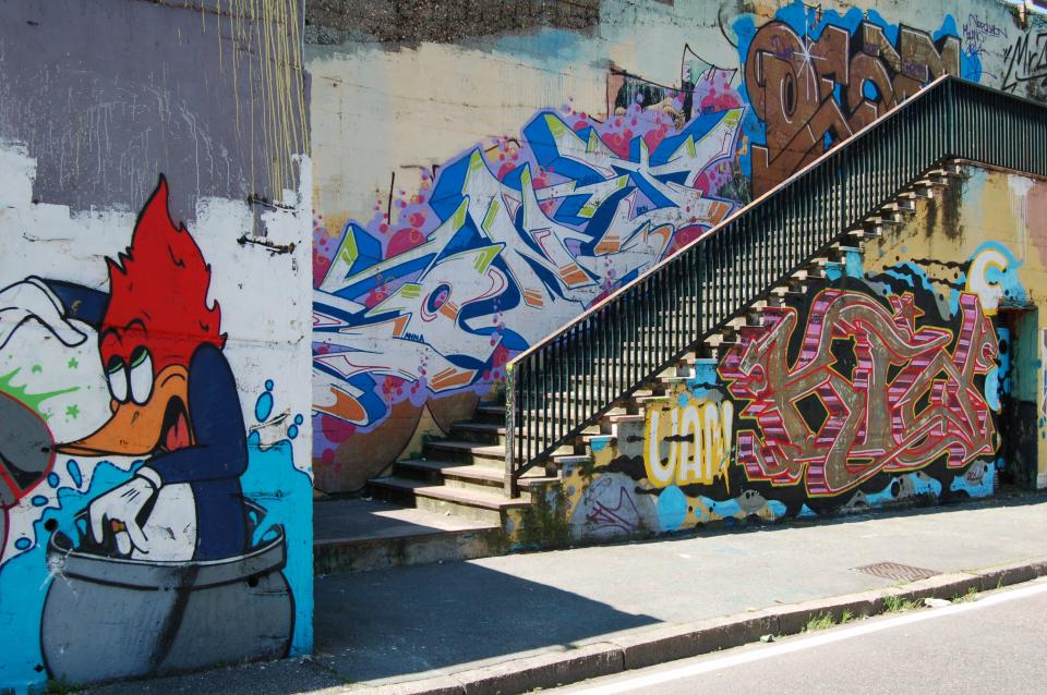 mural painting wall graffiti public art paint colorful street sidewalk stairs
