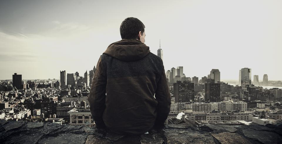 architecture buildings infrastructure city urban tower skyline skyscraper wall people man hoodie jacket alone sky black and white