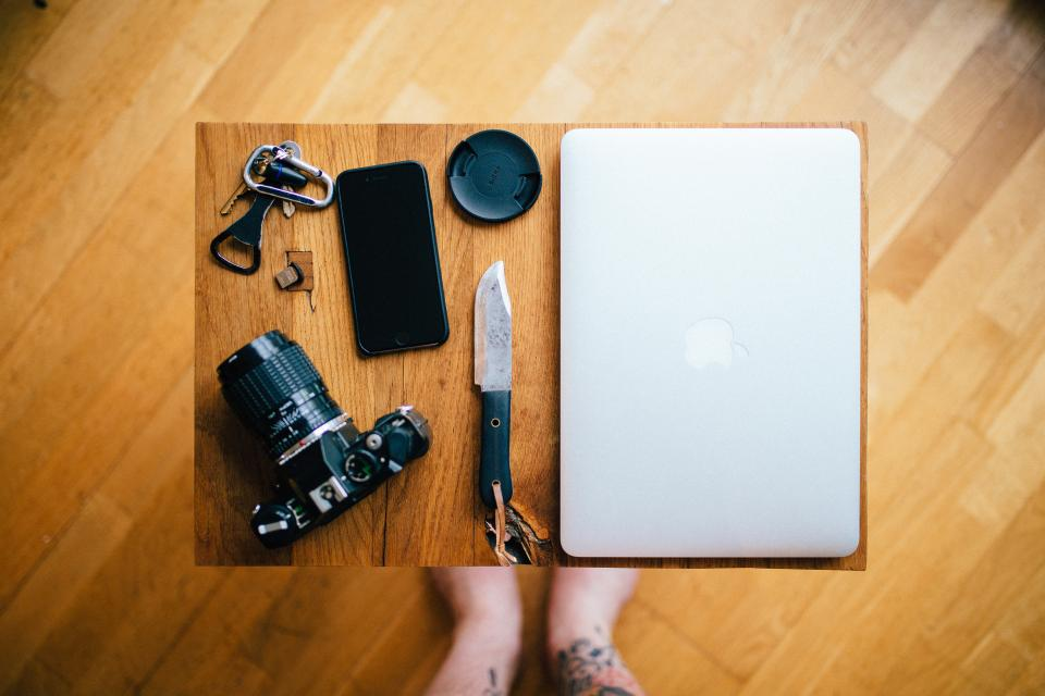 floor table feet chopping board camera lens knife dslr iphone photography