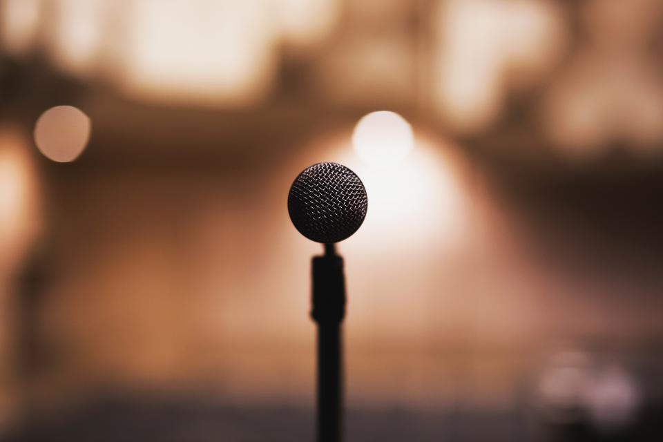 microphone music audio podcast musician concert stage show lights blurry bokeh