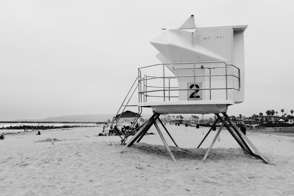beach sand lifeguard black and white