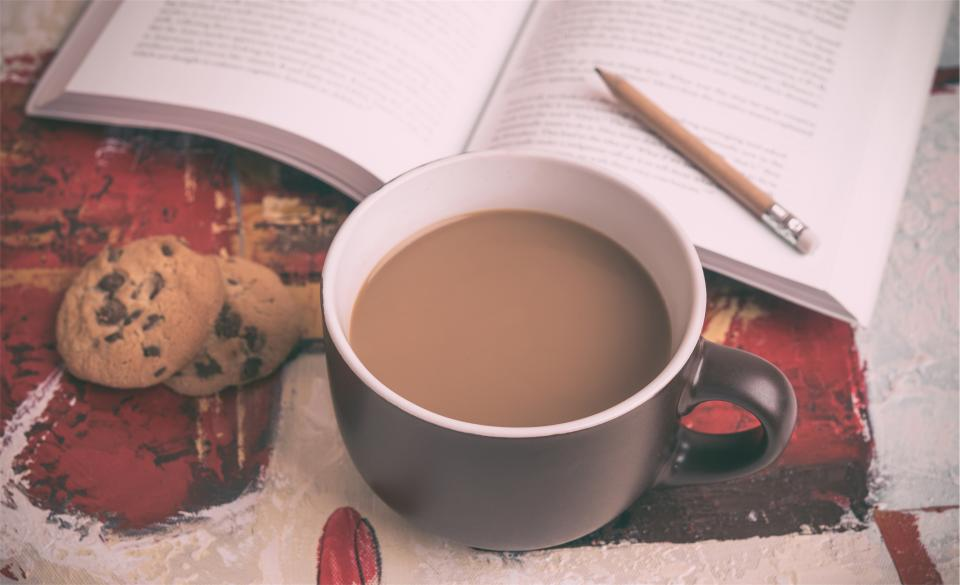 coffee book pencil chocolate chip cookies reading cup mug snack food