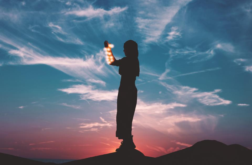 people woman fire light silhouette travel adventure sunset clouds sky