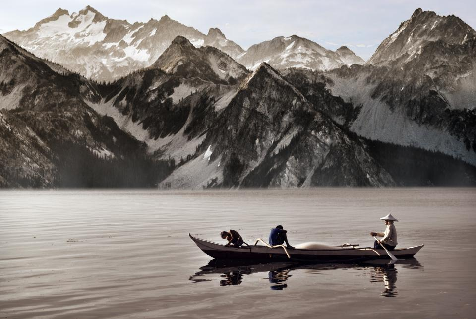 nature landscape mountains summit peaks snow water ocean sea reflection boat row men black and white