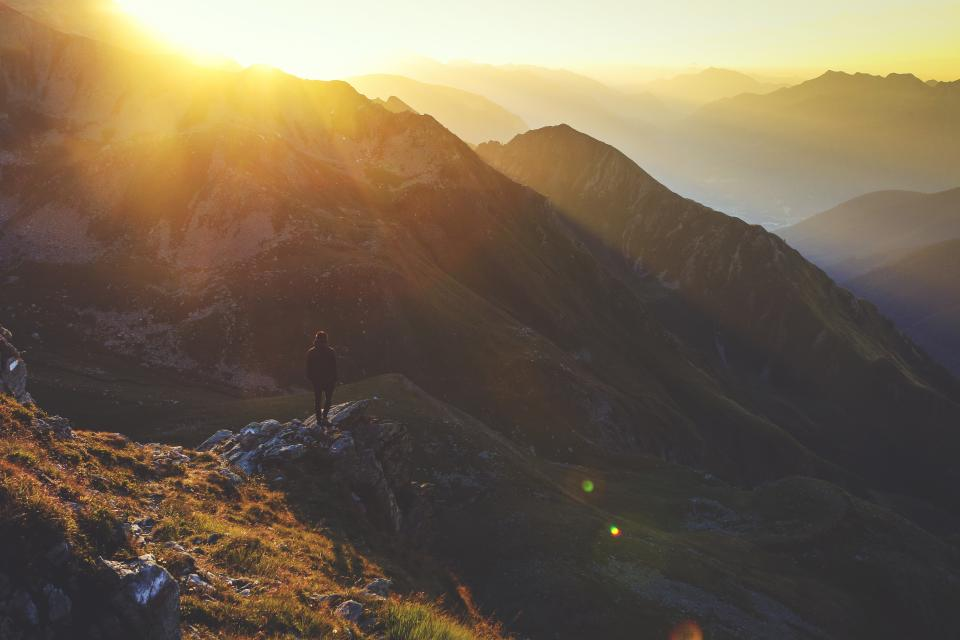 people guy alone sad adventure outdoor mountains sky nature sunlight sunset sunshine shade rocks grass landscape