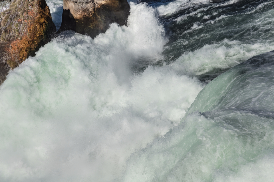 Switzerland Zurich canton Schaffhausen canton water turquoise aqua stream flow view Rhine river Rhine Falls waterfall close up close-up foam splash drop spray white wave cascade rock stone nature landmark sightseeing