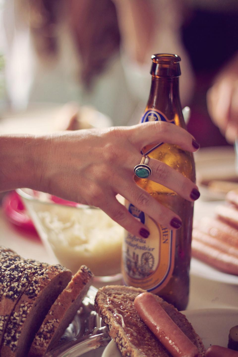 people woman hand manicure ring beer drinks beverage alcohol bread food restaurant kitchen