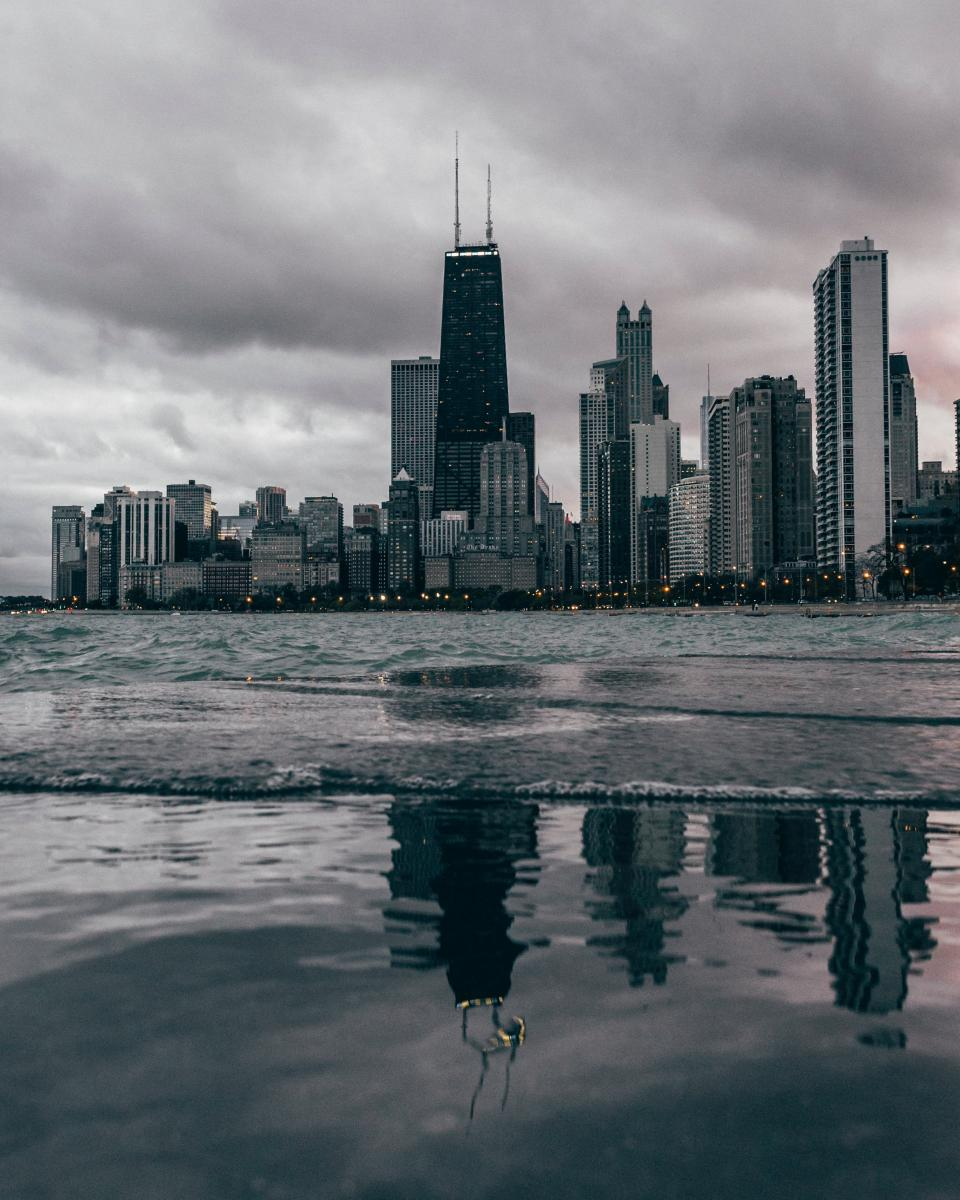 sea ocean water waves nature reflection architecture skyline buildings city clods sky
