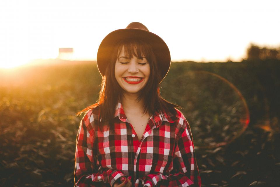 outdoor sunlight sunshine sunrise sunset people woman girl female hat smile happy