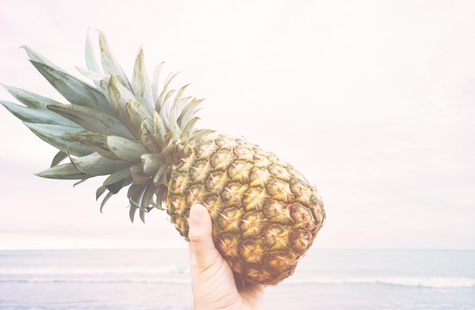 pineapple dessert appetizer fruit juice crop beach ocean sea sand waves people hand
