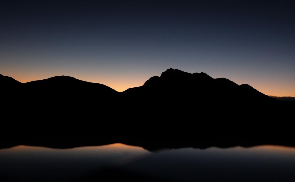 dark mountain highland landscape nature sky silhouette reflection