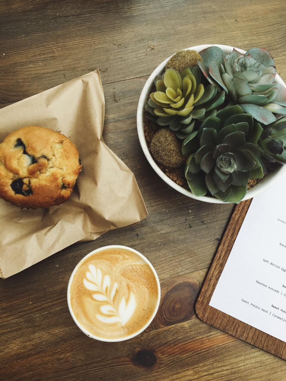 menu boar wooden table coffee latte hot drink breakfast bread muffin food plant