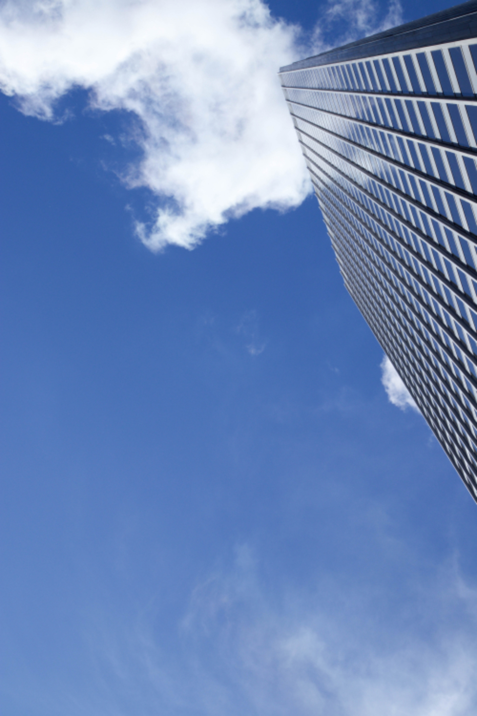 city building windows sky clouds downtown urban skyscraper architecture daytime business copyspace perspective exterior modern
