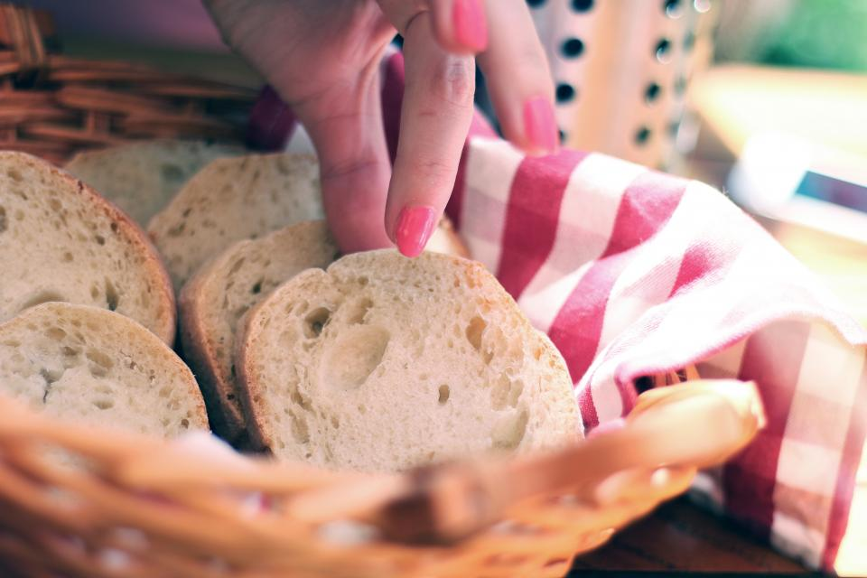 bread basket food hands fingers nail polish