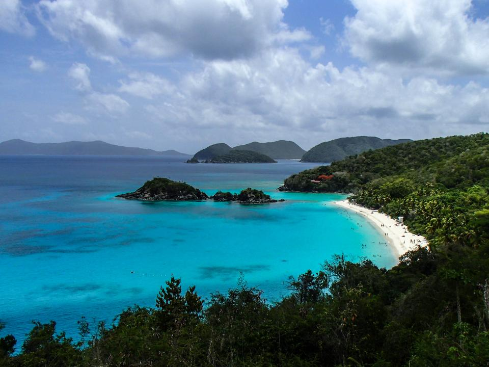 beach tropical vacation sand mountains trees hills water shore ocean sea sky clouds