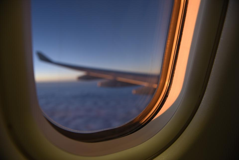 airplane window airline travel flight trip