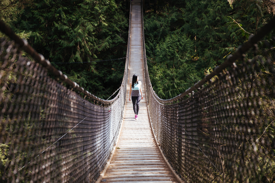 woman bridge hiking walking forest trees nature outdoors suspension girl fence explore adventure travel