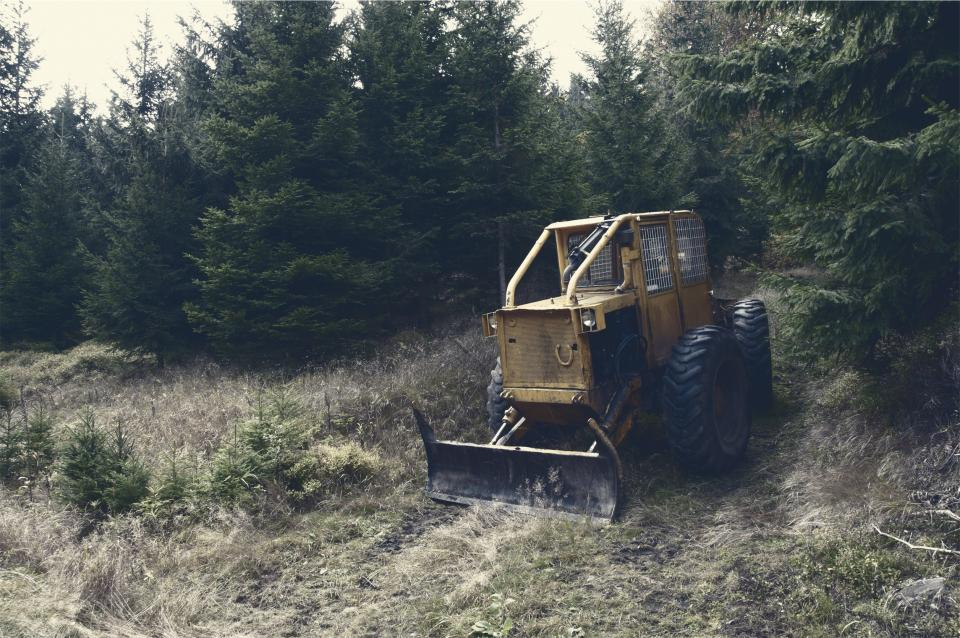 backhoe tractor construction rural trees grass