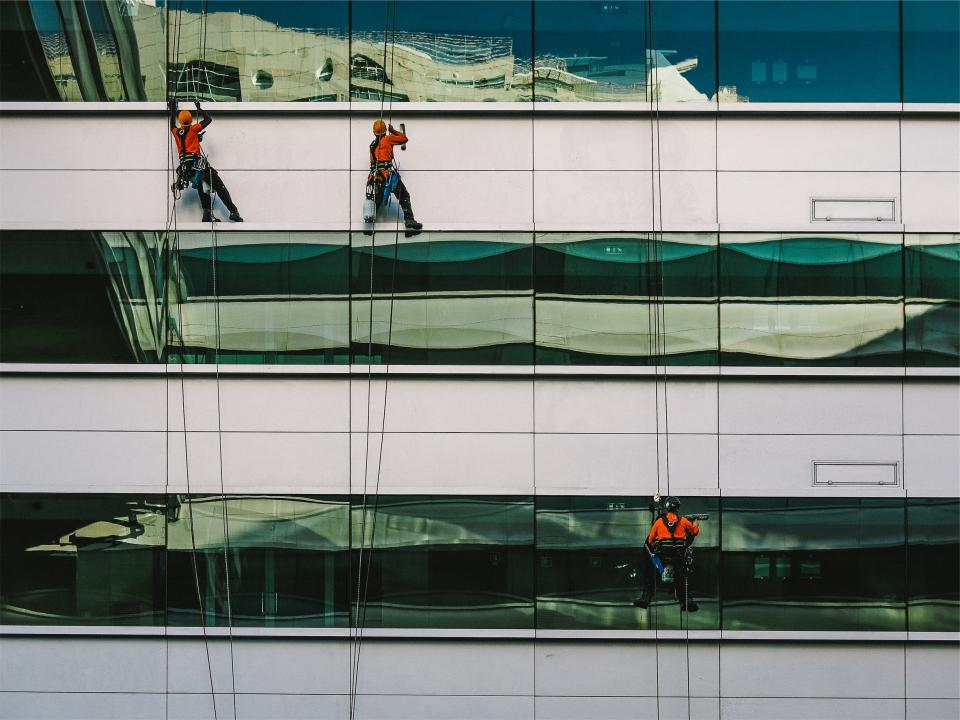 windows washing workers building reflection architecture contractors