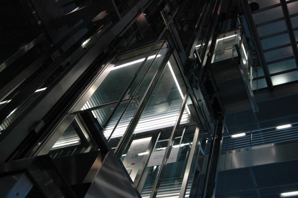 urban city buildings metal elevator lights modern