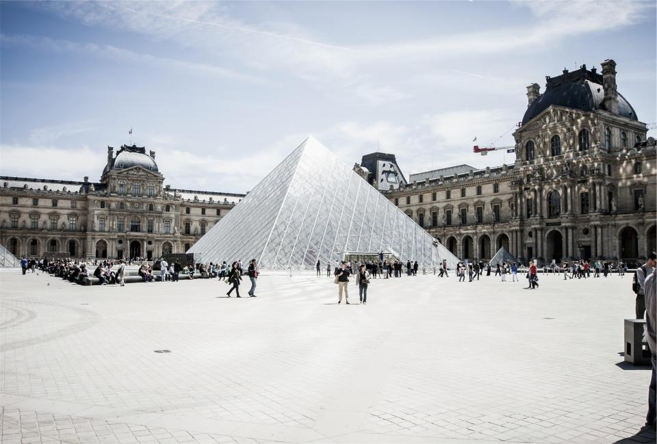 The Louvre Paris France architecture art gallery museum people crowd tourists buildings