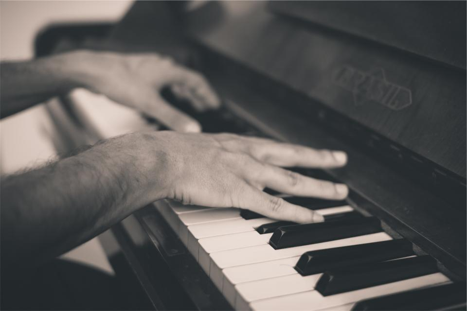 piano keys hands musical instrument music