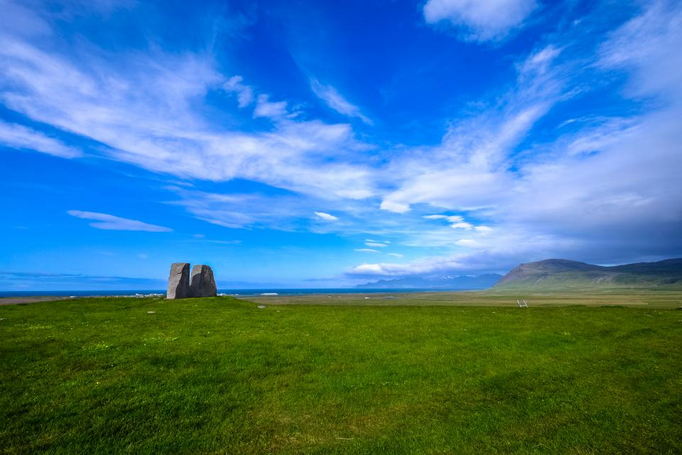 beautiful landscape view nature green grass lawn field grassland mountain outdoor clouds blue sky